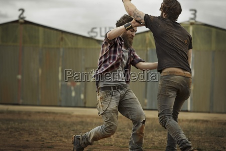 two men with full beards fighting