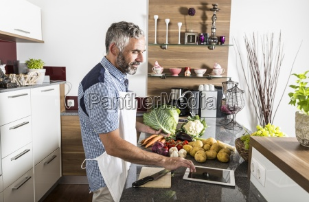 austria man in kitchen with digital