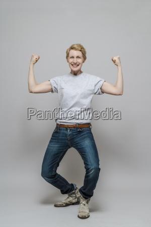 female winner standing in front of