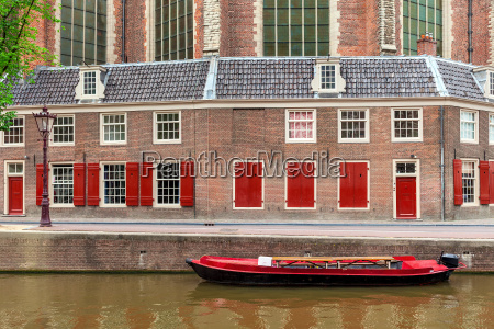 boat and brick building on background