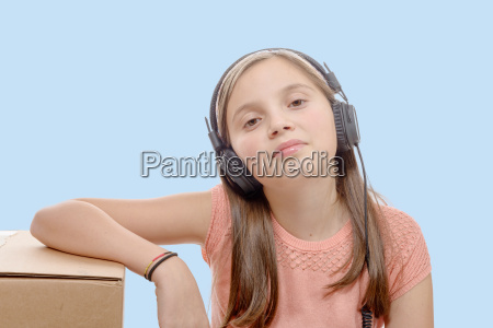 preteen, listening, to, music, with, headphones, - 16339387