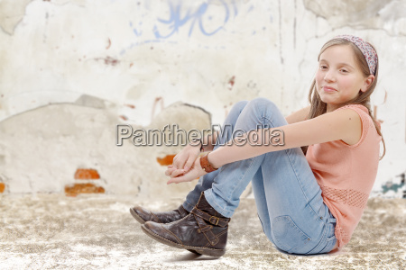 young, preteen, sitting, on, the, floor - 16339403