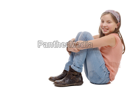 young, teenager, sitting, on, the, floor - 16339399