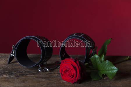 handcuffs and rose