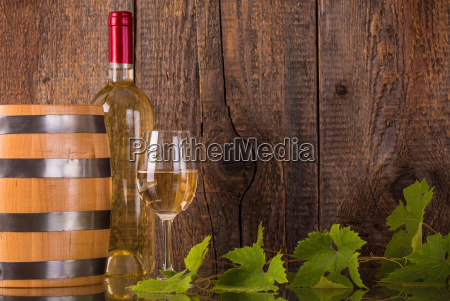 glass of wine with white bottle