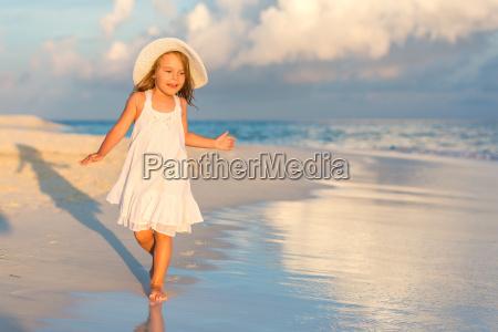 little, girl, on, the, beach - 16344709