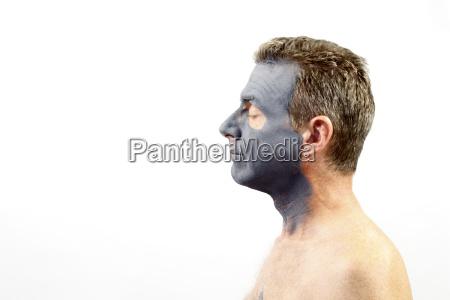 man, wearing, a, charcoal, bentonite, mask - 16344273