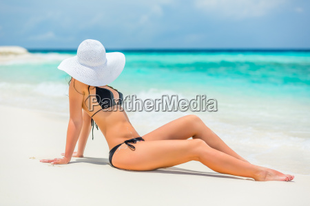young, woman, on, the, beach - 16344739