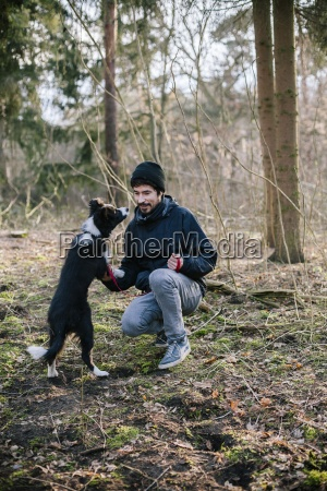 germany man with border collie