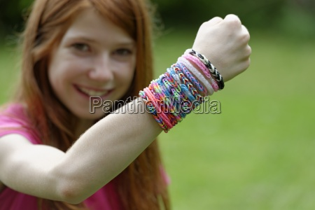 smiling girl showing self made looms