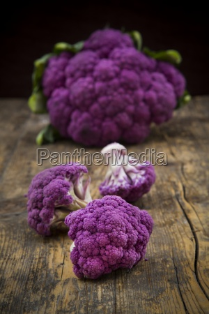 whole purple cauliflower and cauliflower florets