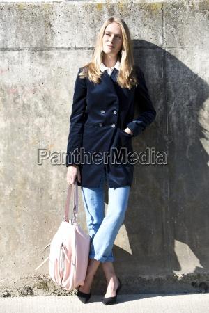 young woman wearing velvet blazer standing