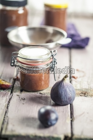 preserving jar of plum fig jam
