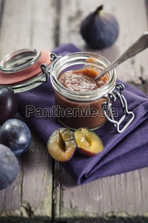 opened preserving jar of plum fig