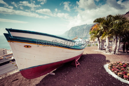 colourful painted fishing boat near the