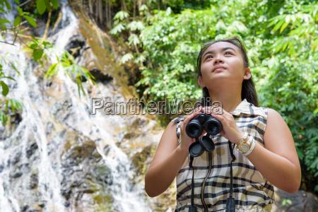 girl, using, binoculars, in, forest - 16356199