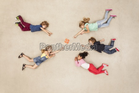 children discovering new mini gadget