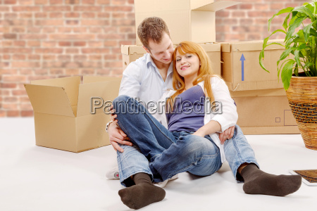 happy, couple, sitting, in, new, house - 16357277