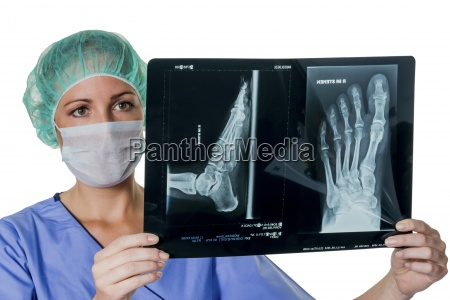 doctor looking at x ray of