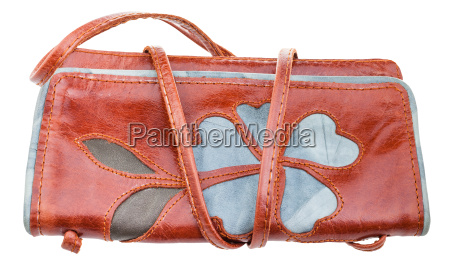 little brown handbag decorated by flower