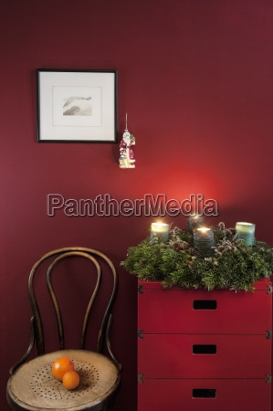 advent wreath on sideboard at red