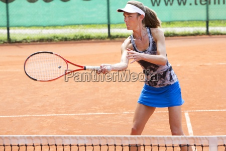 female tennis player playing on tennis