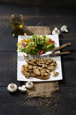 fried schnitzel with mushrooms and salad