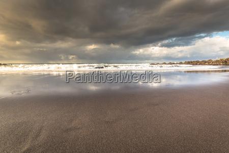 black pebble beach in puerto de