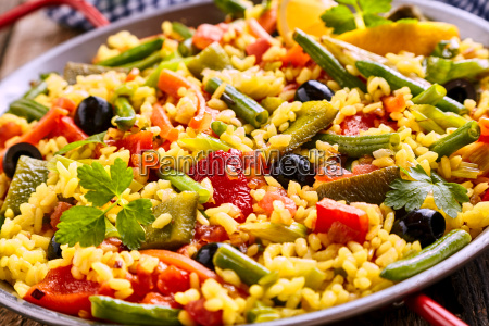 colorful vegetarian paella rice dish served