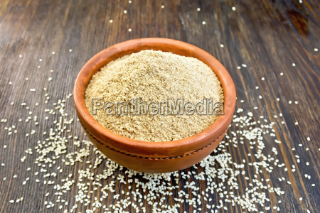 flour sesame in clay bowl on