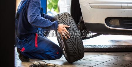 inside a garage changing wheelstires
