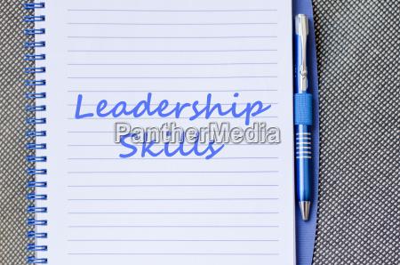 leadership skills write on notebook