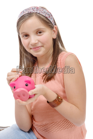 preteen with a piggy bank on