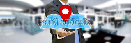 businessman holding digital map in his