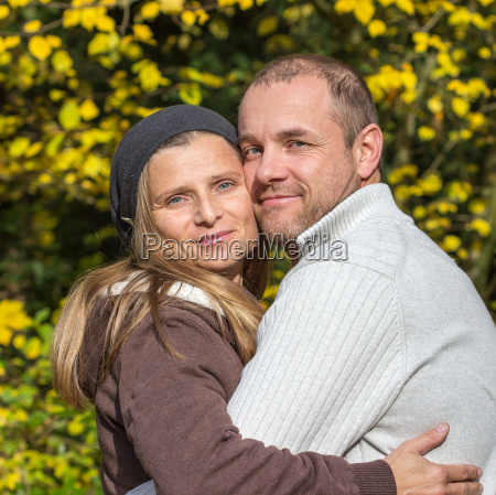 happy couple embracing in park
