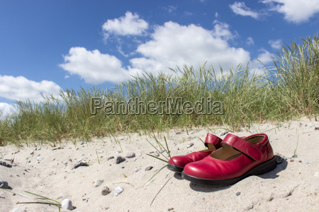 red shoes on a sandy beach