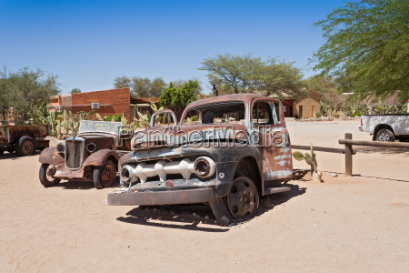 old rusted car in front of