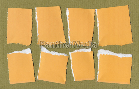 yellow torn paper pieces
