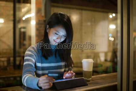 woman using tablet for online shopping