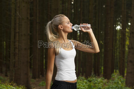 young female jogger with a water
