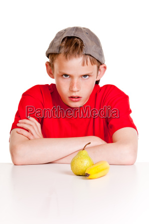 defiant young boy glowering at the