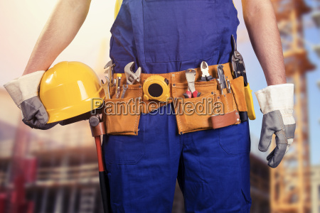 construction worker with tool belt at