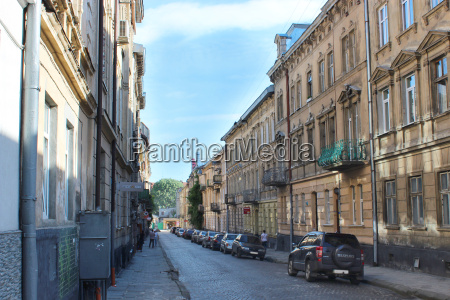 street in lviv with parked cars