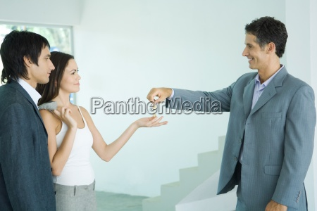 real estate agent holding out keys