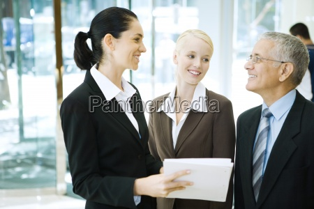 business associates standing smiling at each
