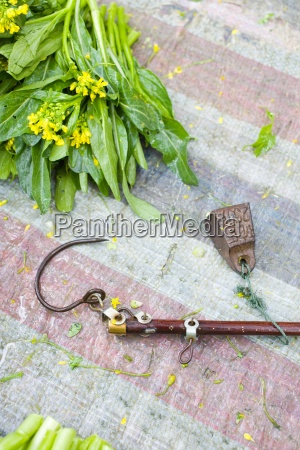metal hook lying on market table