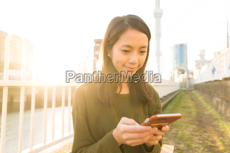 woman use of cellphone at tokyo