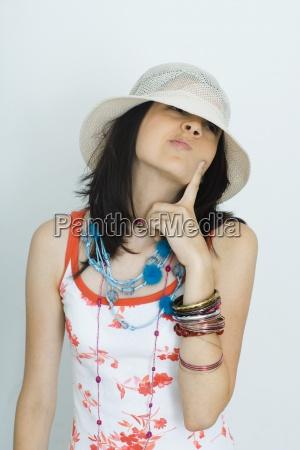 teenage girl wearing hat looking away