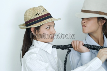 two young female friends dressed in