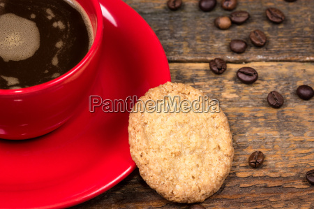 coffee cup with biscuit on table